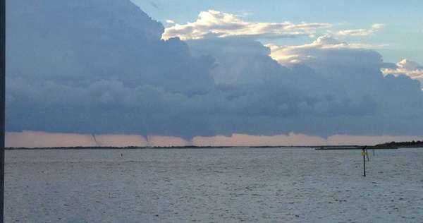 Waterspouts are seen in the distance at Moriches