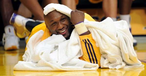 Los Angeles Lakers forward Lamar Odom watches the
