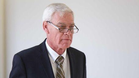 Smithtown Highway Superintendent Glenn Jorgensen walks through State