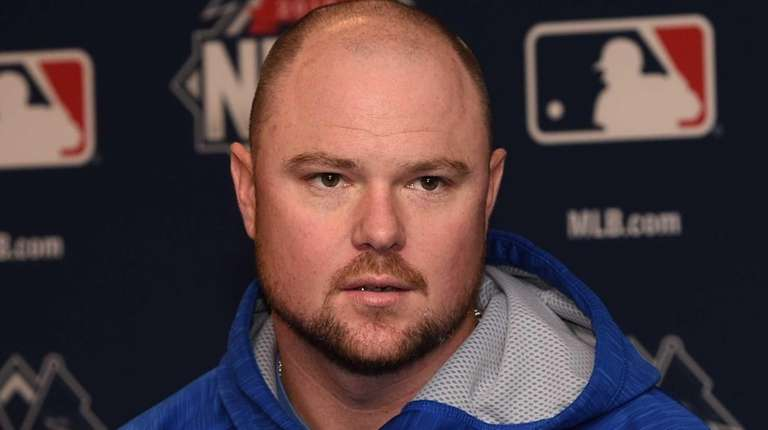 Chicago Cubs starting pitcher Jon Lester answers questions