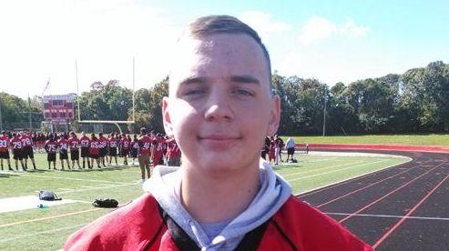 Newfield High School football player Zach DiSalvo hangs