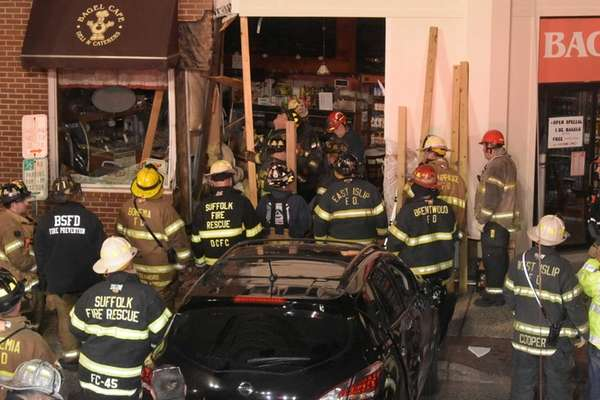 Firefighters inspect the Bagel Cafe on West Main