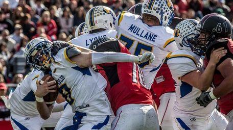 West Islip quarterback Conor Smith rolls off a