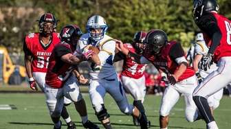 West Islip's Jake Guercio gains yards in the