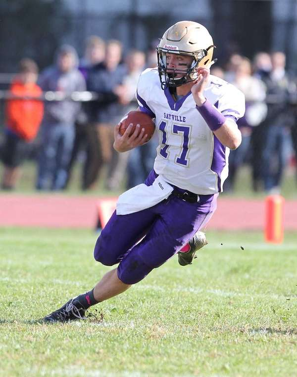 Sayville's Jack Coan runs the ball for 17