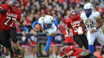 Lawrence quarterback Akym Land soars through the air