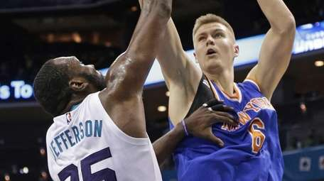 New York Knicks' Kristaps Porzingis shoots over Charlotte