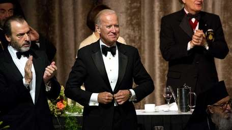 Vice President Joe Biden stands up before speaking