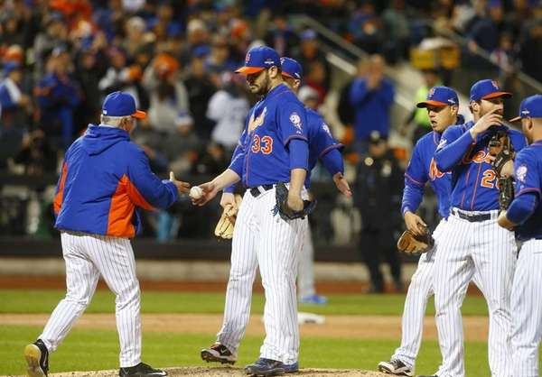 New York Mets manager Terry Collins (10) grabs