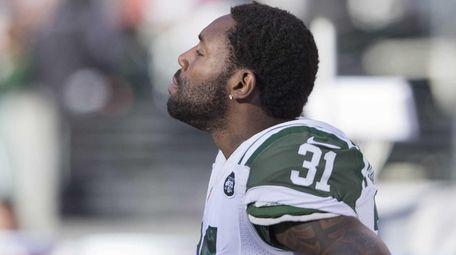 New York Jets cornerback Antonio Cromartie looks on