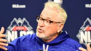 Chicago Cubs manager Joe Maddon (70) speaks to