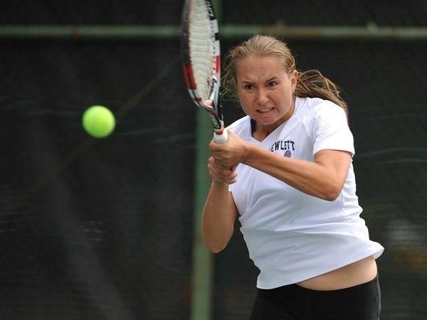 Kseniya Zonova of Hewlett returns a volley during