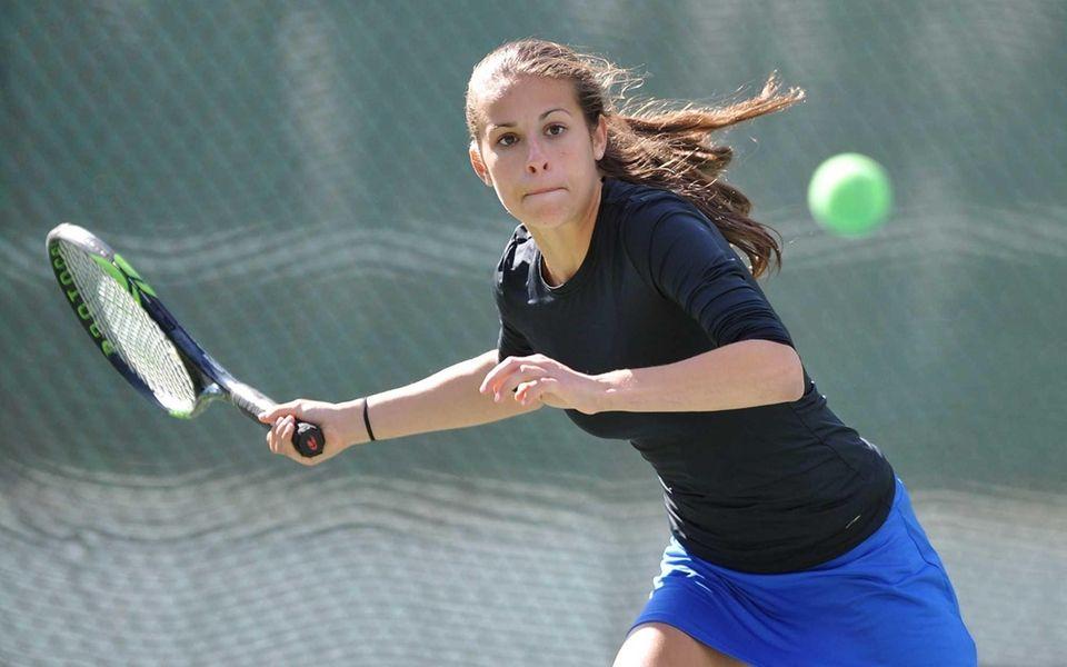 Emma Rosenberg of Port Washington returns volley during