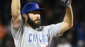 Chicago Cubs starting pitcher Jake Arrieta (49) reacts