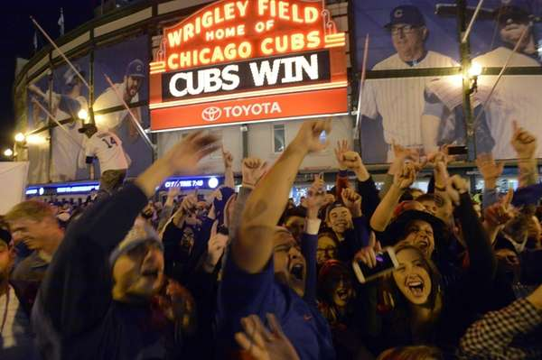 Fans gather on the streets outside of Wrigley