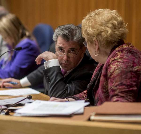 Town Board member Gene Cook, sits during a