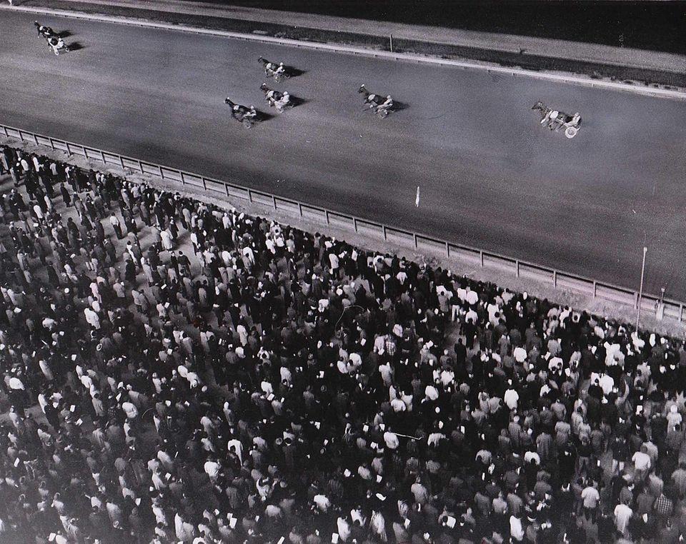 Fans watch the contenders in an early race