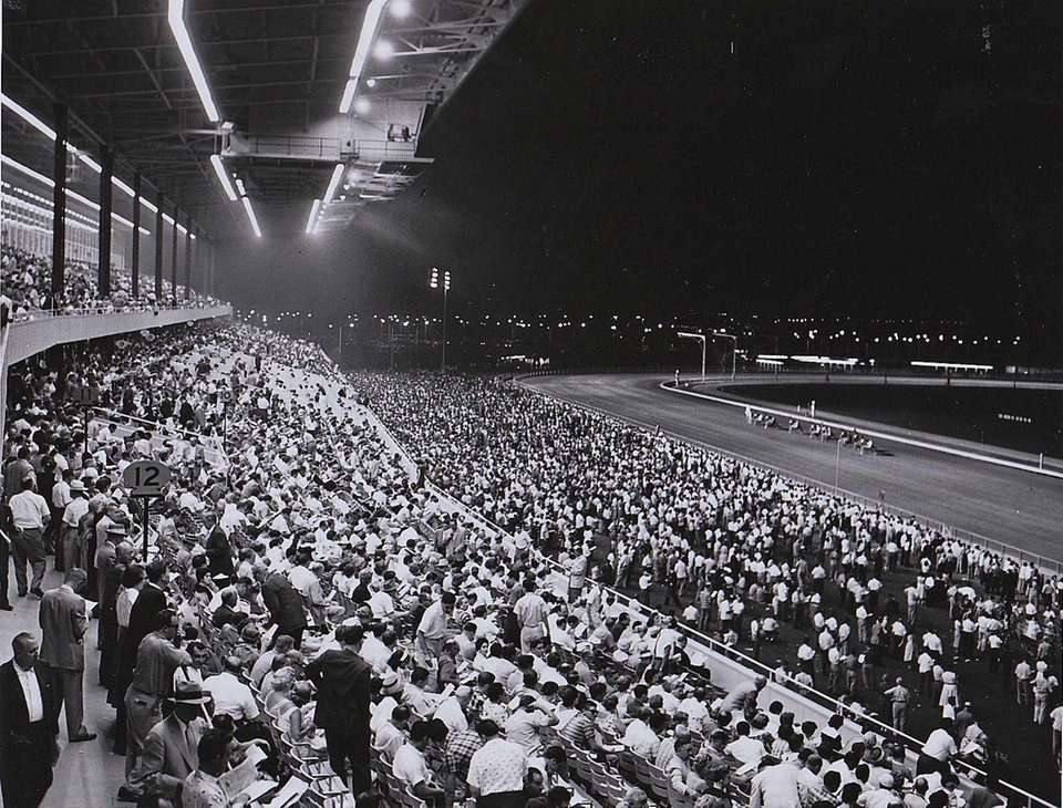 Spectators watch the races on the season's opening