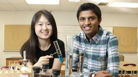 Syosset High School students Sarah Lee, left, and