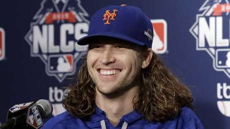 New York Mets pitcher Jacob deGrom talks at