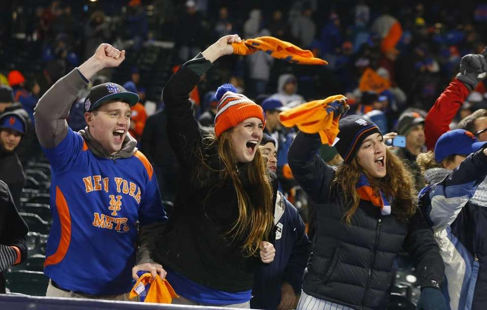 New York Mets fans celebrate the win during