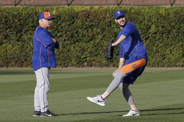 New York Mets manager Terry Collins, left, watches