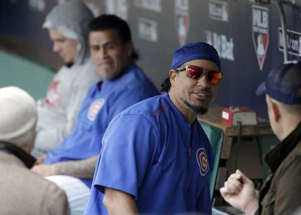 Manny Ramirez talks to reporters in the dugout