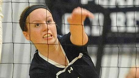Massapequa's Jamie Smith makes a spike attempt during