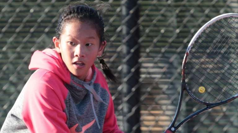 Kimberly Liao of Commack returns a shot from
