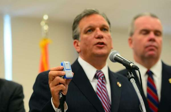 Nassau County Executive Ed Mangano, holds a wireless