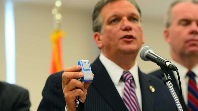 Nassau County Executive Ed Mangano, holds a wireless