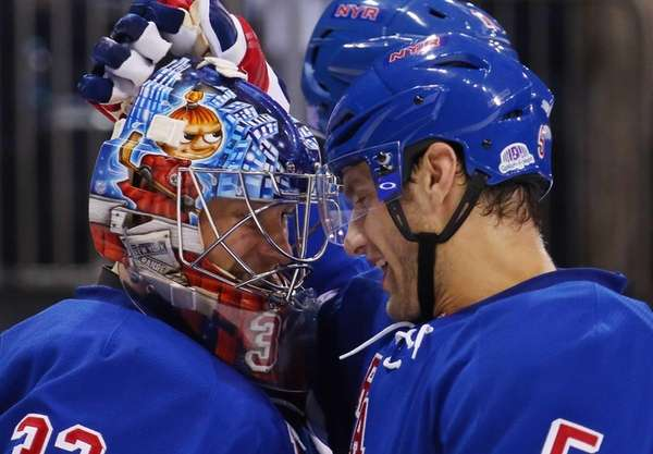 Antti Raanta #32 and Dan Girardi #5 of