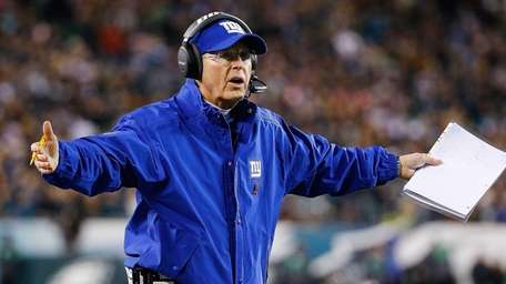 Giants head coach Tom Coughlin questions a call