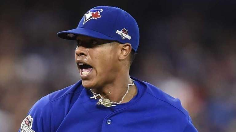 Toronto Blue Jays starting pitcher Marcus Stroman reacts