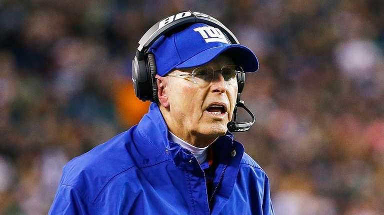 Giants head coach Tom Coughlin looks on during