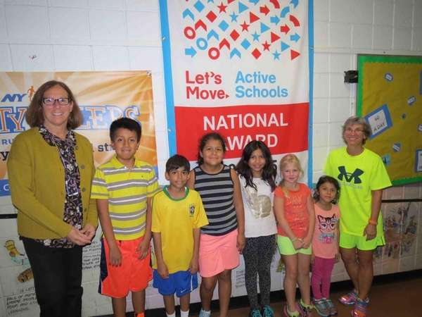 Manorhaven Elementary School Principal Bonni Cohen, far left,