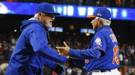 Chicago Cubs manager Joe Maddon (70) and New