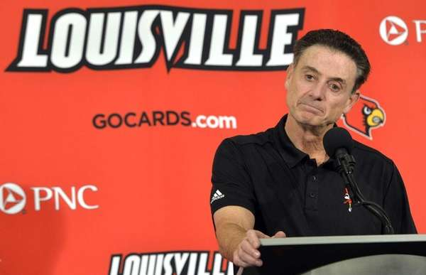 Louisville head coach Rick Pitino responds to a