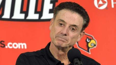 Louisville head coach Rick Pitino responds to a