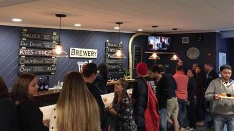 Patrons enjoy the beer at Northport's new Sand