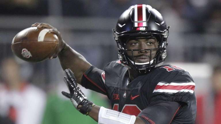 Ohio State quarterback J.T. Barrett drops back to