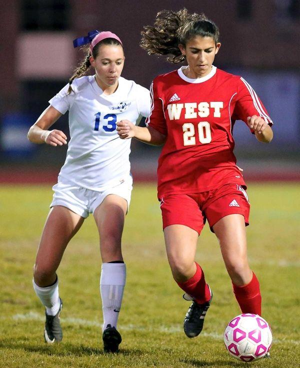 Hills West's Dana Winthrop and Hauppauge's Emily Kaplan