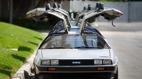 DeLorean cars parked outside The DeLorean Motor Company