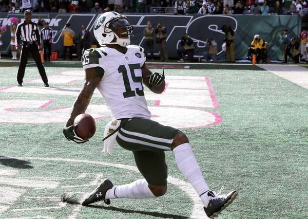 New York Jets wide receiver Brandon Marshall scores