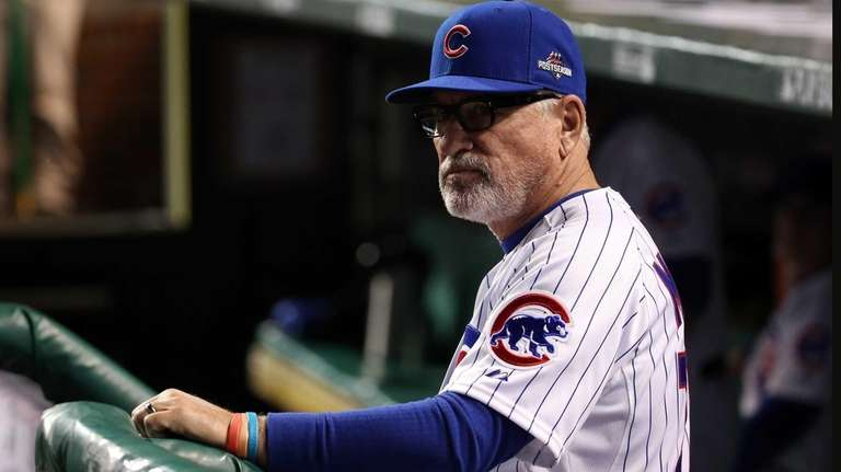 Joe Maddon of the Chicago Cubs looks on