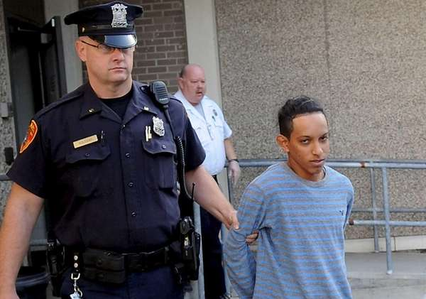 Orlen Soliz-Galvez, 18, of Amityville, is escorted out