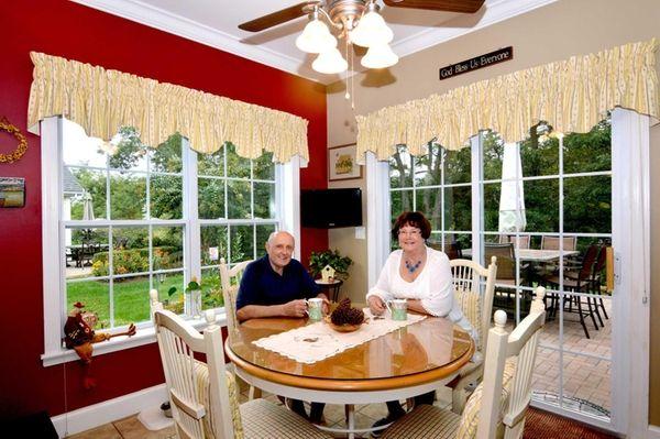 Jack and Maureen Tyniec sit in their kitchen