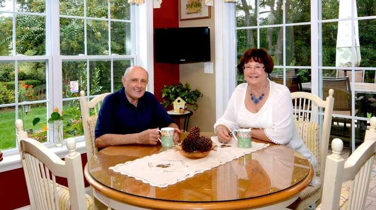 Jack and Maureen Tyniec sit in their kitchen