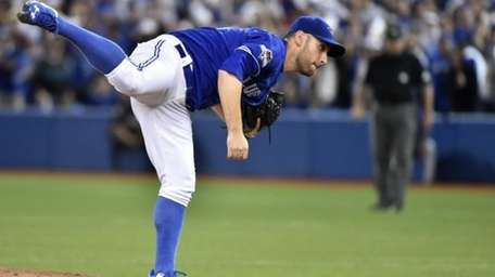 Toronto Blue Jays' starting pitcher Marco Estrada throws