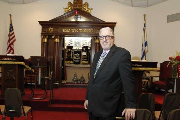 Rabbi Michael Eisenstein is shown in the temple